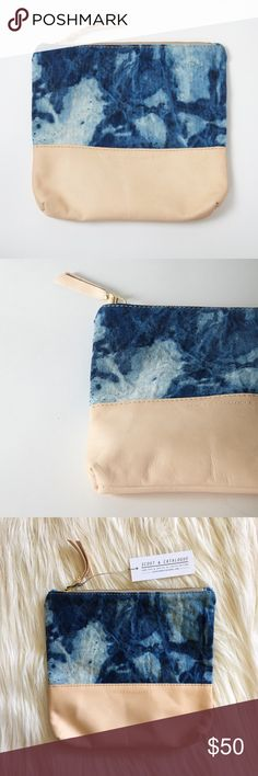 "Indigo Clutch This purse is handmade with thick canvas dyed by hand and distressed vegetable tanned leather. The pattern is a beautiful blue. Measures 8""x 9"". Gold 8"" zipper. This clutch is from an online company I run which no longer sells leather products. The clutch is handmade and brand new. A few marks on the leather, but they're from the natural leather. These were selling at $78 and this is the last one left. Bags Clutches & Wristlets"