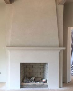 Wondering if this works in family room? Tying in shape of range hood to family room fireplace? Stucco Fireplace, White Fireplace, Fireplace Remodel, Modern Fireplace, Brick Fireplace, Fireplace Surrounds, Fireplace Design, Transitional Fireplaces, Two Story Fireplace