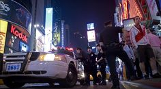 Police officers look on at the intersection of 45th Street and Seventh Avenue on Sunday in New York's Times Square where a car bomb was found a day before.