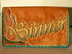 Tooled leather business card case. $40.00, via Etsy.