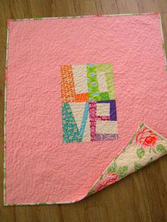 Pretty and simple. This would be a great gift quilt for hand-written messages from family and friends.  Also a cute idea for the back side of a quilt.