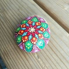 Check out this item in my Etsy shop https://www.etsy.com/listing/533667817/hand-painted-mandala-stone-original-one