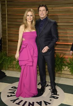 Actors Kelly Preston (L) and John Travolta attend the 2014 Vanity Fair Oscar Party hosted by Graydon Carter on March 2, 2014 in West Hollywood, California.