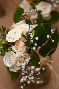 Nosegay with white roses Hypericum berries, Italian rest, curly willow, baby's breath and tied with burlap and raffia. The bride opted for these instead of corsages for the mothers and the grandmothers