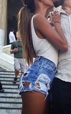 cut up Levi's .... LOVE LOVE LOVE... with a deep carved white shirt! Ripped jean shorts with white tank top
