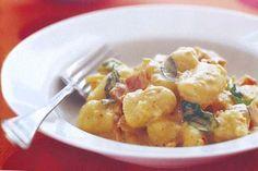 Creamy gnocchi with bacon and pesto