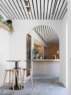 black beam lines on ceiling wwhite stucco walls and concrete or slate - Slate Cafe Decoration