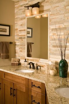Stone backsplash (and matching stone-styled tissue box!) give this master bathroom a unique crafted flare.- love the stone backsplash Casa Stark, Stone Backsplash, Backsplash Design, Backsplash Ideas, Vanity Backsplash, Bathroom Backsplash Tile, Quartz Backsplash, Hexagon Backsplash, Black Backsplash