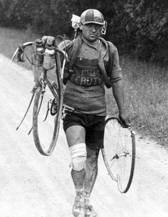 Italian Giusto Cerutti carries his broken bicycle after a fall. According to the rules in 1928 he was not allowed to accept any help