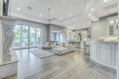 spectacular living room design-grey-hardwood-floor white furniture