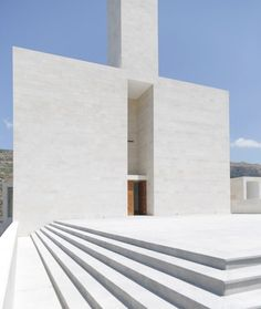 Stone-clad church with cross-shaped windows by Paris-based architect Maroun Lahoud
