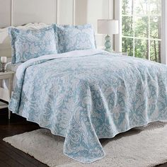 Refresh your master suite or guest room with this lovely cotton quilt set, showcasing a damask motif in blue and neutral hues.  Prod...