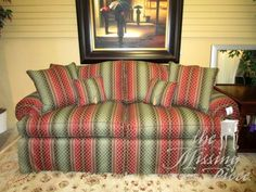"""Thomasville two-seat traditional sofa in wine and spruce. This striped upholstery has gold woven throughout just adding to the richness of the fabric. Comes with four matching accent pillows. 82""""L x 37""""D x 37""""H. Arrived: Wednesday October 19th, 2016"""