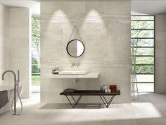 Modern resort bathroom with AVT Bone tiles from Novabell.