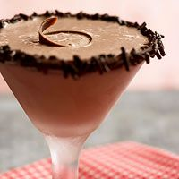Chocolate Blitzen Martini - Bailey's, Vodka, Creme de Cacao, Chocolate Ice Cream with Melted Semi-Sweet Chocolate and sprinkles on the rim. This recipe serves 8!