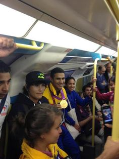 Venezuelan fencing champion Ruben Limardo travelling on the tube with his Olympic gold medal.