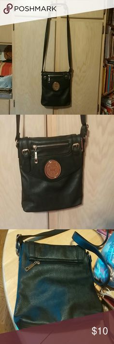 Nice Black Leather like crossbody Nice cross body bag lots of zippers, And spacious inside nice size bag, Nice no tips or stains 🚫Non smoking house None Bags Crossbody Bags