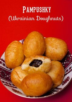 Pampushky - Ukrainian Doughnuts filled with either poppy seed or prunes my grandma made them with jelly on christmas eve.