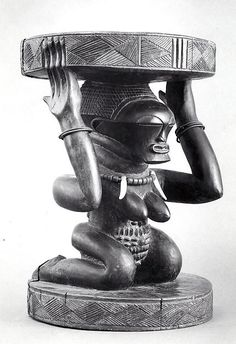 Prestige Stool: Female Caryatid Date:19th–20th century Geography:Democratic Republic of the Congo Culture:Songye peoples Medium:Wood, metal, ivory, beads Dimensions:H. 19 13/16 x W. 13 3/8 x D. 13 1/8 in. (50.4 x 34 x 33.3 cm) Classification:Wood-Furniture