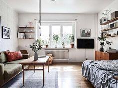 Wall-mounted shelves take up far less floor space than bookshelves.