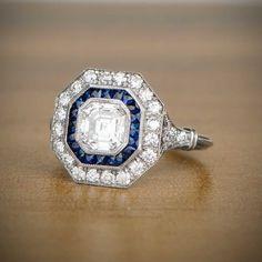 1.05ct Asscher Cut Diamond and Sapphire Ring - Vintage Engagement Ring - VS2 Clarity - Triple Wire Platinum Setting - Fleur de lis by EstateDiamondJewelry on Etsy https://www.etsy.com/listing/164317422/105ct-asscher-cut-diamond-and-sapphire