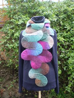 This scarf is knitted in one long strip only ten stitches wide. The waves at the sides are a repeated pattern of short rows and the strip is joined as you go so there's no sewing up to do. Any yarn and needles can be used and the pattern can also be used to knit a blanket. Like my other Ten Stitch designs, this pattern is easy to memorise.