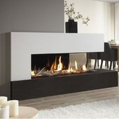 A real panoramic fire in your home: the DRU Metro gas fireplace. A real panoramic fire in your home: the DRU Metro gas fireplace. The DRU Metro gas fi 3 Sided Fireplace, Fireplace Feature Wall, Fireplace Windows, Living Room Decor Fireplace, Home Fireplace, Fireplace Remodel, Fireplace Design, Home Living Room, Fireplace Modern