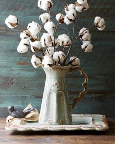 You don't have a farmhouse without cotton! Grab a bundle (you can find some here) and decorate in a rustic vase!  More DIY Fixer Upper Farmhouse Style Ideas on Frugal Coupon Living. Decorating with Cotton.
