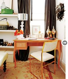 Dressing room continued  Meredith indulged her feminine side in the dressing room, opting for a palette of pink, coral and gold pulled directly from the antique Aubusson rug. Black curtains prevent the room from becoming too precious.