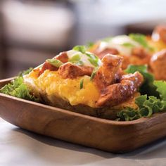 Buffalo chicken twice-baked potatoes  http://www.myrecipes.com/recipe/buffalo-chicken-twice-baked-potatoes-10000001626819/