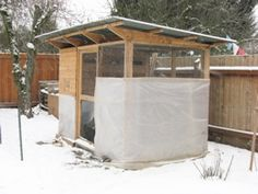 Winter Chicken Coop Care, Part Outfit your chicken coop for the winter. limit drafts while keeping circulation, partially cover hen house and run, secure weak spots, add extra bedding Chicken Coop Blueprints, Chicken Coop Plans, Building A Chicken Coop, Portable Chicken Coop, Backyard Chicken Coops, Chickens Backyard, Chicken To Go, Chicken Runs, Chicken Coop Winter