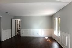 Sherwin Williams Front Porch on the top and Pure White on the wainscoting. Handscraped engineered hardwood for the flooring.