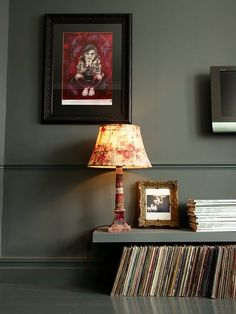Gemma Ahern: pairing IKEA LACK shelves with vinyls. Painted laminate floating wall shelves. Installed close to the floor for custom, classical look.