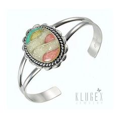 Material: .925 sterling silver  Gemstones: mosaic inlay yellow jasper, green jasper,koral  Length in inch: 6-3/4 inch inside circumference including 1-1/4 inch gap Width: 1-3/8 inch wide at widest point