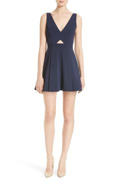 A deep V-neckline underscored by a flirty triangle cutout is echoed by the plunging V-back of a precisely tailored fit-and-flare dress that transitions seamlessly from work to play in crisp navy blue.