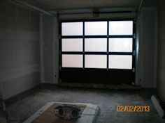 Before the metal element sign went up. Inside the garage looking out through the new glass garage door. Once the porch light...