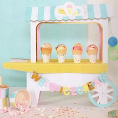 Have something different at your summer party with this ice cream cart centerpiece in assorted pastel colors with wheel, striped awning, and instruction for ass