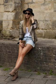 Dress up a pair of denim shorts with a sequin blazer.