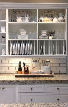 DIY plate rack on top cabinet, bottom shelf, paint thin wood boards to hold dishes.