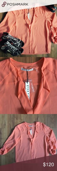 NWT Alice + Olivia Coral Silk Blouse Alice + Olivia blouse in silk & a bit of spandex.  Split neckline. Roll-tab sleeves and yoked back shoulders. Relaxed, skimming fit. Pullover style. Silk/spandex. The color was the hardest to truly capture. It's listed as coral. The stock photo is too orange but wanted you to see a good photo of the style. Most like the second photo. Alice + Olivia Tops Blouses