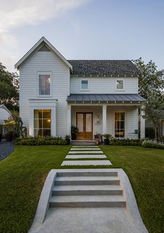 Shingles on the main roofline and standing seam metal on the porch over hang only...  Something to consider...