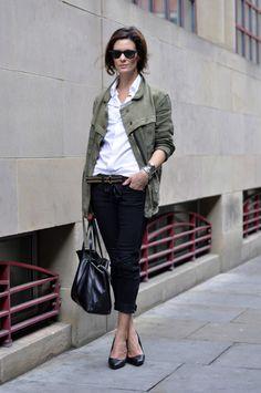 crisp white shirt, army jacket, low-slung trousers.
