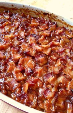 Ingredients 10 slices bacon halved 1 yellow onion finely diced 1/2 green bell pepper finely diced 54 oz can pork and beans or equivalent number of smaller cans 4 Tbsp ketchup 1/4 cup molasses 2/3 cup brown sugar 1/4 cup cider vinegar 2 tsp