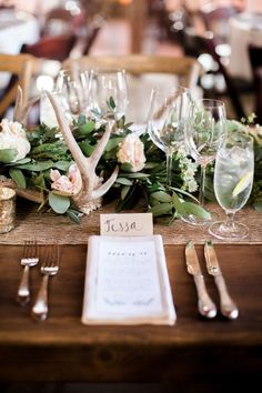 Rustic table decor with antlers and bare wood:Photography: Brittrene Photo - http://brittrenephoto.com/?utm_content=bufferf3d00&utm_medium=social&utm_source=pinterest.com&utm_campaign=buffer/?utm_content=bufferf3d00&utm_medium=social&utm_source=pinterest.com&utm_campaign=buffer