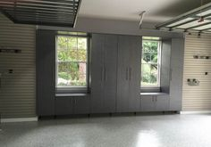Beautiful garage installation by Tailored Living of Orlando, FL, featuring tall cabinets for plenty of storage!