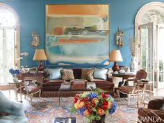 Danielle Rollins' opulent Atlanta home, designed by Miles Redd, has a living room that can seat 40 and features an Oushak carpet, walls upholstered in Brunschwig & Fils silk satin, and a painting by Agustin Hurtado.   - Veranda.com