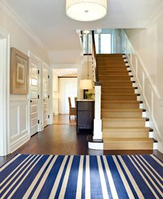 This clean interior utilizes royal blue and gold to complement each other and stand out against the palette of white and dark brown.