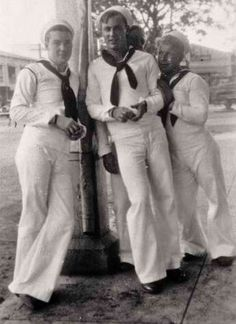 GROUP OF 4 YOUNG SAILORS, IN THEIR DRESS WHITES, CAUGHT IN A CANDID  MOMENT.