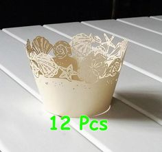 Wrapper fit for standard cupcake Qty: 12 pcs Color: Ivory Bottom diameter ~ 5.2cm Top diameter ~ 8cm Height ~ 5cm Material : High Quality Paper / Pearlized Paper  Thanks for visiting my shop:D https://www.etsy.com/shop/bigdaykingdom  We accept custom design. Please contact me for details. Please noted Wrappers are for presentation only - not to bake in. The wrappers will be shipped into flap. If you need a larger quantity, please let me know.  Item will be sent by nor...