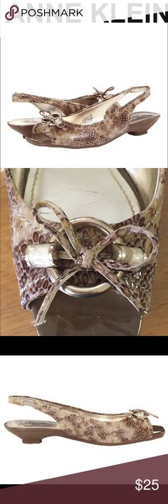Snake skin Sling back sandals Anne Klien Jacenta Snake iflex Sandals.  Put a sleek spin on your look with these sophisticated slingbacks! Easy slip-on wear with elastocized strap. Brown/tan/beige snake kin pattern with a 1in Wrapped kitten heel Man-made lining. Lightly worn.  In great condition  . Shoes Sandals